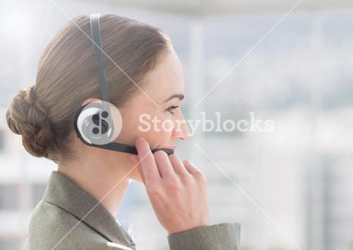 Customer service executive in headset talking with a client