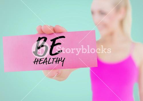 Woman holding placard with text be healthy