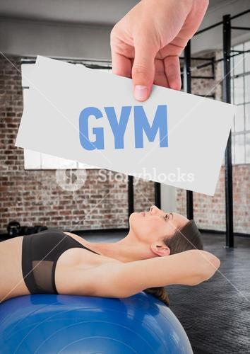 Fitness woman lying over exercise ball with hand holding text with placard