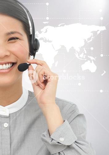 Woman with headphones against digitally generated world map