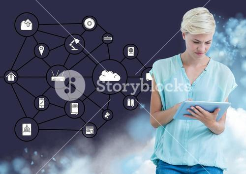 Woman using digital tablet against interface of connecting icons in the background