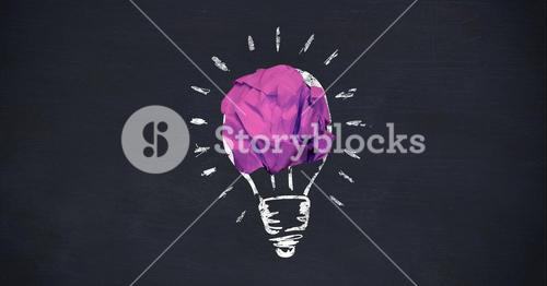 Crumpled paper ball forming a lightbulb on chalkboard