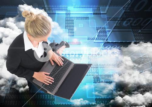 Digital composite image of businesswoman working on laptop