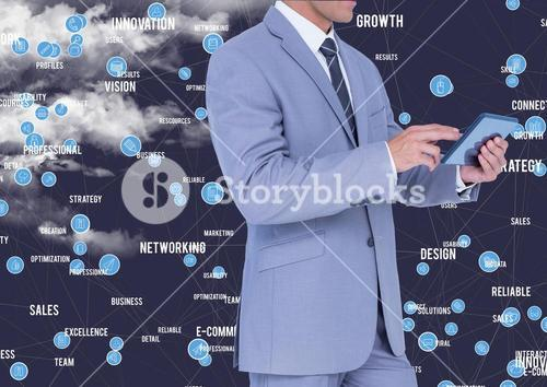Businessman using digital tablet against cloud computing icons