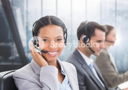 Portrait of smiling customer service woman talking on headset