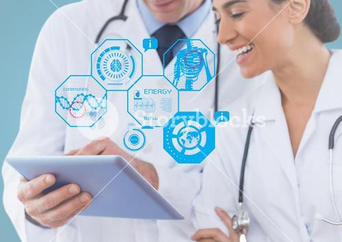 Doctors using digital tablet with multiple models interface in clinic