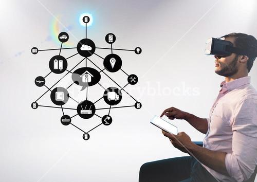 Man using digital tablet while wearing virtual reality headset with cloud connectivity interface