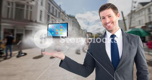 Businessman standng posture hand with laptop and cloud
