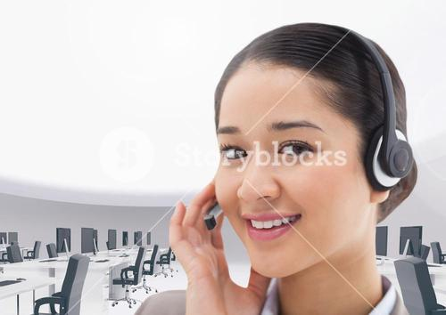 Portrait of a smiling businesswoman talking on headset in office