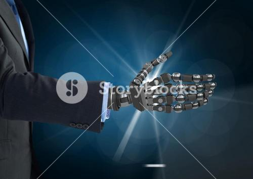 Businessman with robot hand against dark blue background and white light