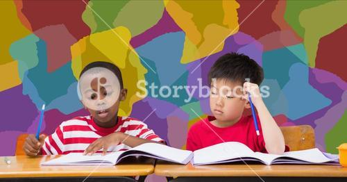 School kids studying at desk in classroom with colorful background
