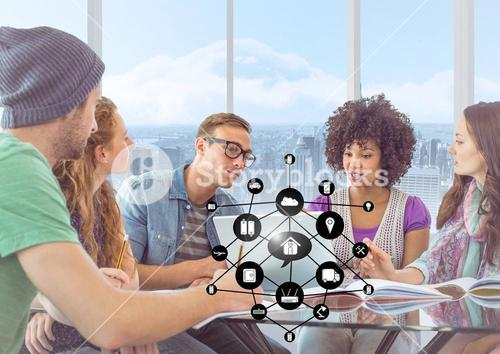 Executives discussing over digital tablet in office and networking icons