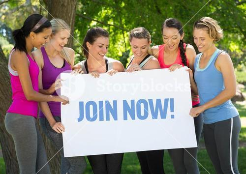 Group of happy women holding placard with text join now