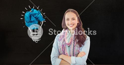 Portrait of a smiling woman with crumbled paper on a drawn light bulb in background