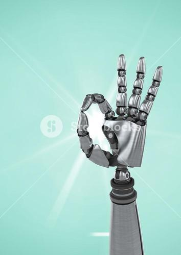 Robot hand showing ok sign against turquoise background