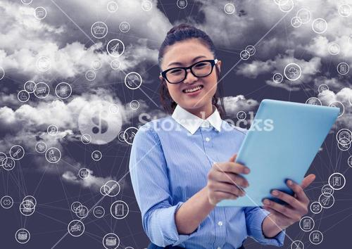 Portrait of woman holding digital tablet with connecting icons and cloud in background
