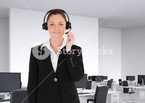 Portrait of customer service woman in headset standing in office
