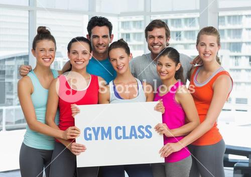 Portrait of happy people holding placard with text gym class