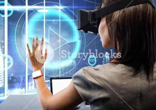 Woman using virtual reality headset against play icon in background