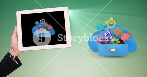 Hand holding digital tablet against application icons on green background