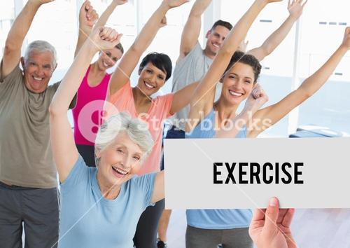 Hand holding placard that reads exercise against people doing aerobics