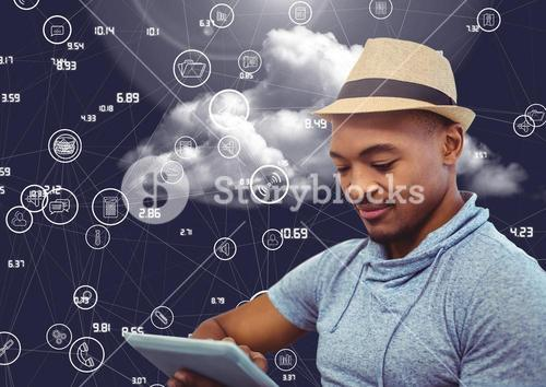 Businessman using digital tablet against cloud computing concept in sky