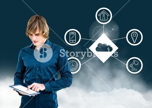 Man using digital tablet against cloud computing concept in background