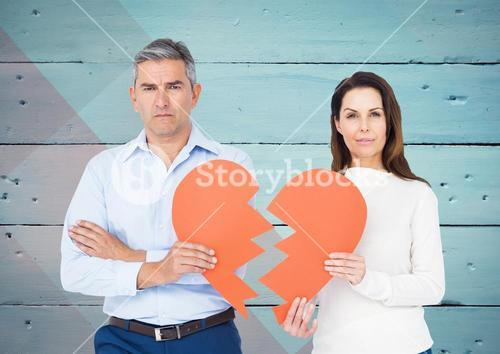Depressed couple holding broken heart