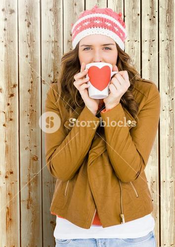 Woman holding a mug with a heart shape on it