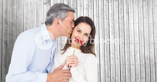Romantic man kissing on the cheek of woman