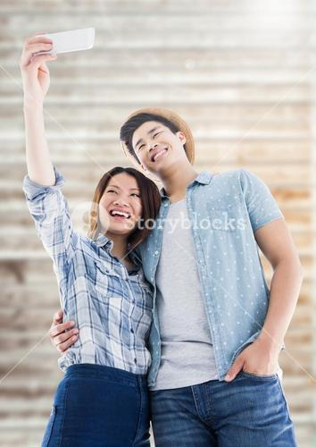 Couple taking selfie from mobile phone