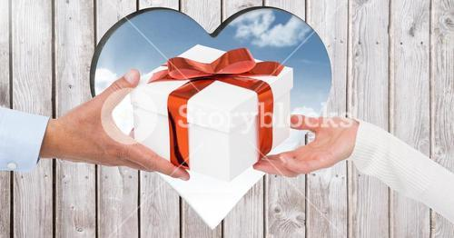 Hands of couple holding a gift