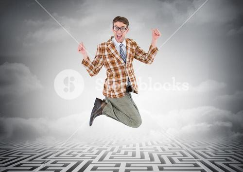 Businessman jumping over maze