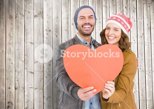 Romantic couple holding a heart