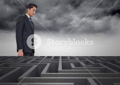 Conceptual image of businessman looking over maze