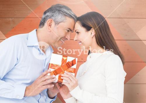 Mature man giving a gift to woman