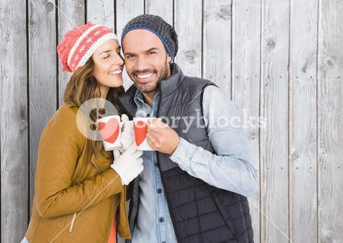 Romantic couple holding coffee mugs