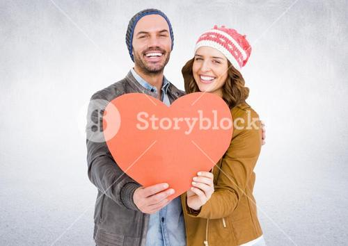 Smiling couple holding a heart