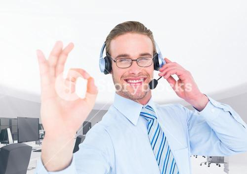 Call center executive wearing headset and making ok sign