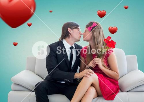 Romantic couple in love while sitting on a sofa