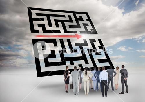 Businesspeople standing and looking at maze