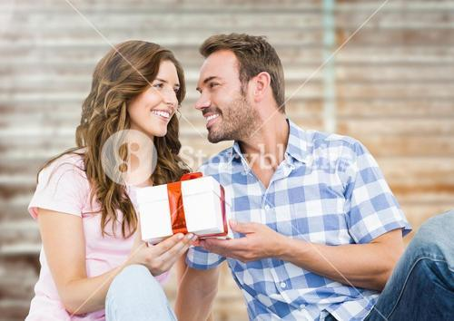 Man giving a gift to woman