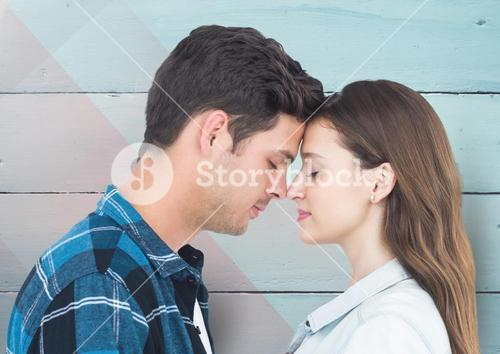 Romantic couple standing with closed eyes