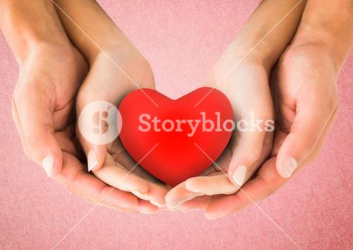 Hands of couple holding a heart