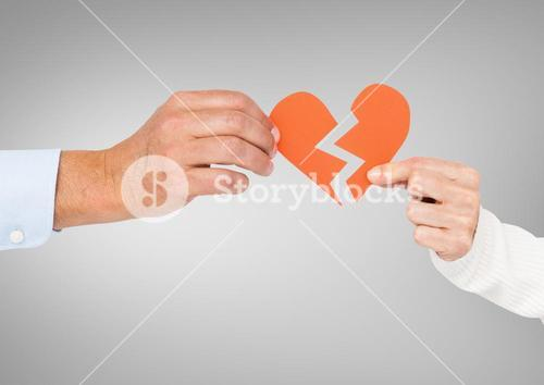 Hands of couple holding a broken heart