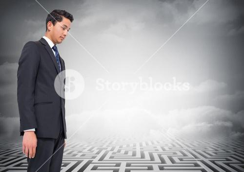 Composite image of businessman looking at a maze
