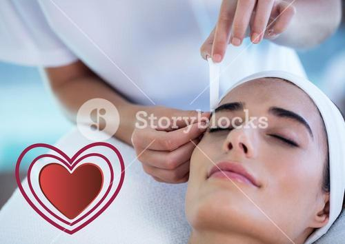 Woman receiving massage at spa center