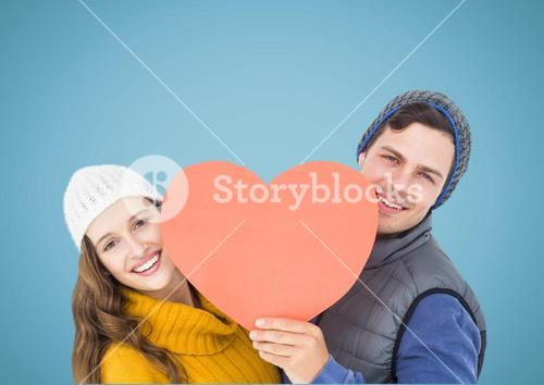 Happy couple holding a red heart