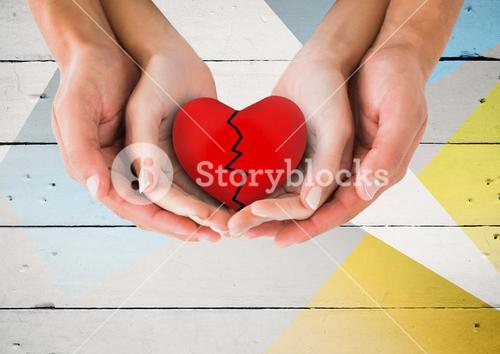 Composite image of couple hands holding broken heart