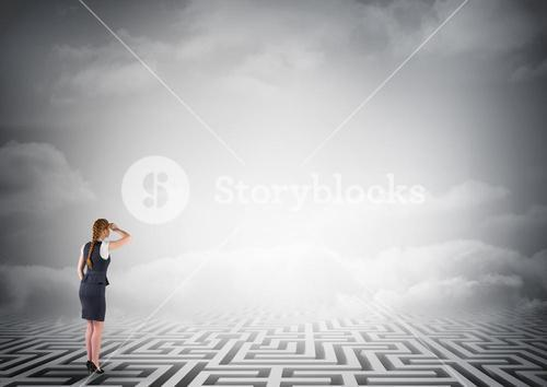 Composite image of businesswoman standing on maze